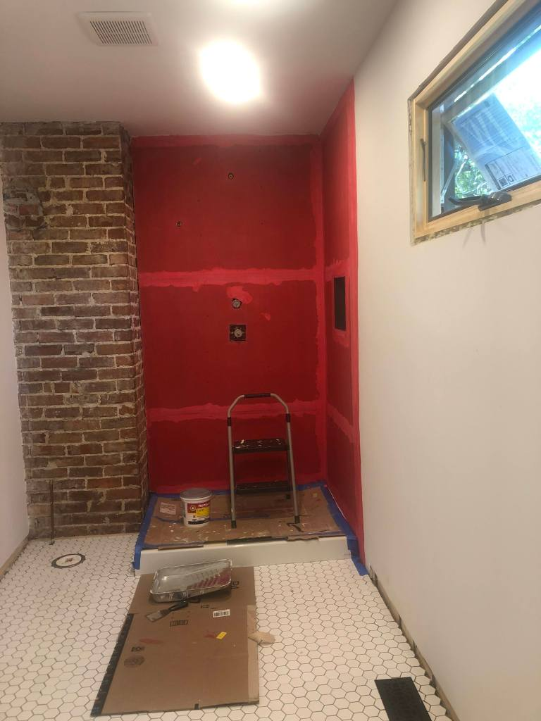 Red Guard waterproofing membrane on the shower walls